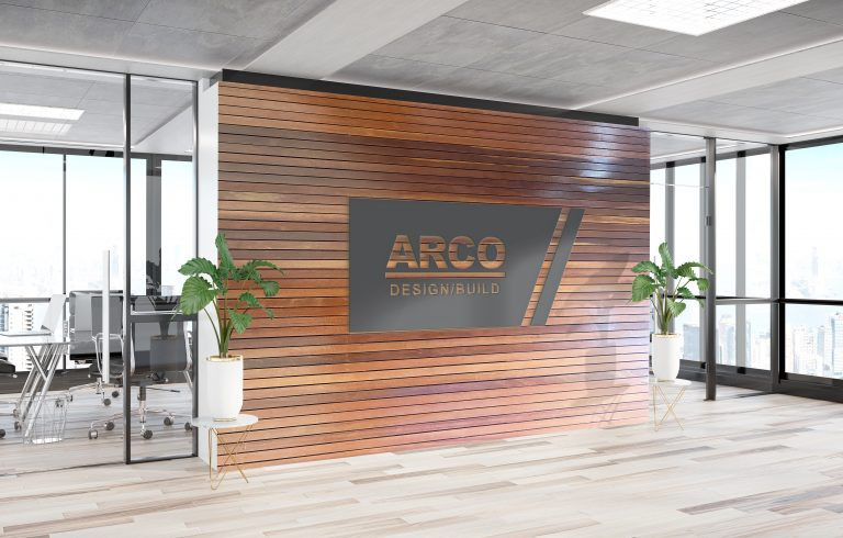 ARCO sign installed on a wall in a modern office