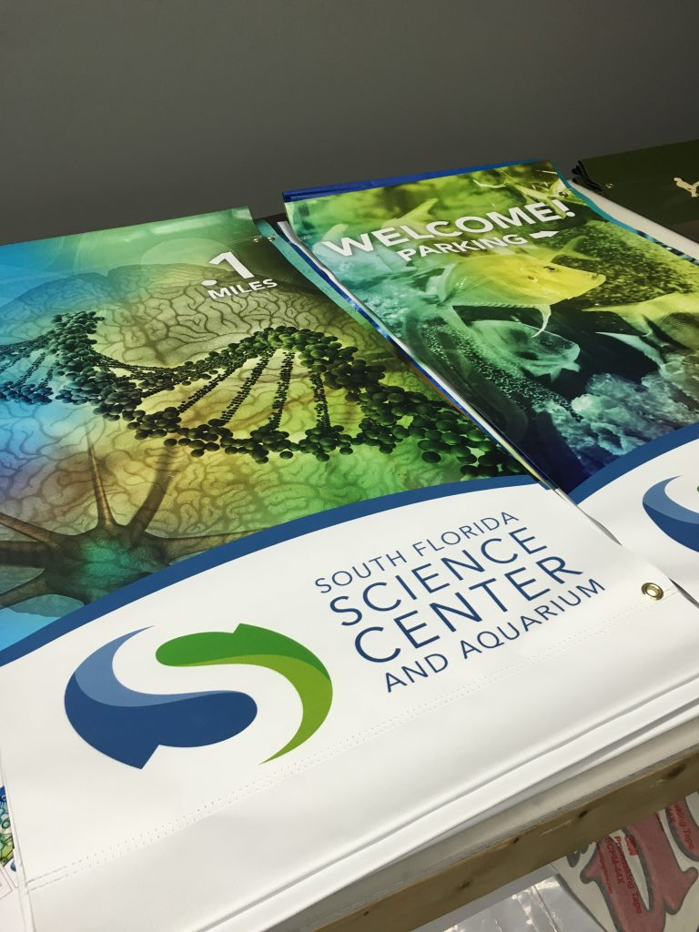 Vinyl outdoor blue and green welcome signs for South Florida Science Center