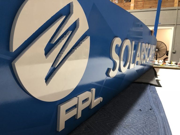 3-dimensional dark blue sign of a company logo named FPL, created by VSP digital Marketing, South Florida