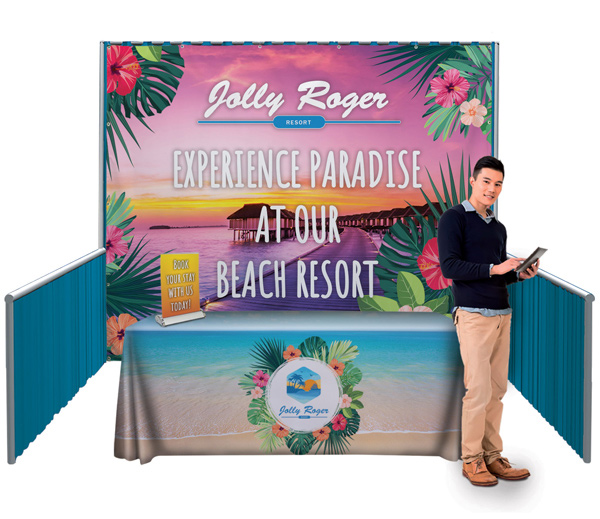 Jolly Roger Resort booth display with table and banner behind a customer service representative.